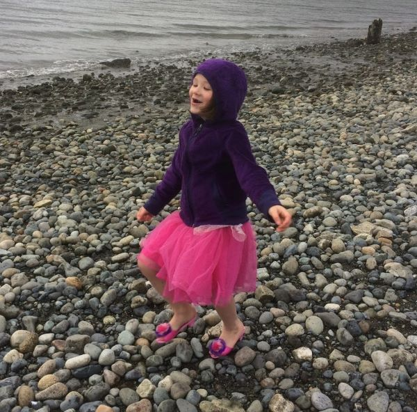 Etta dancing on the beach in pink heels