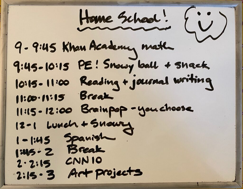 White board with home school schedule
